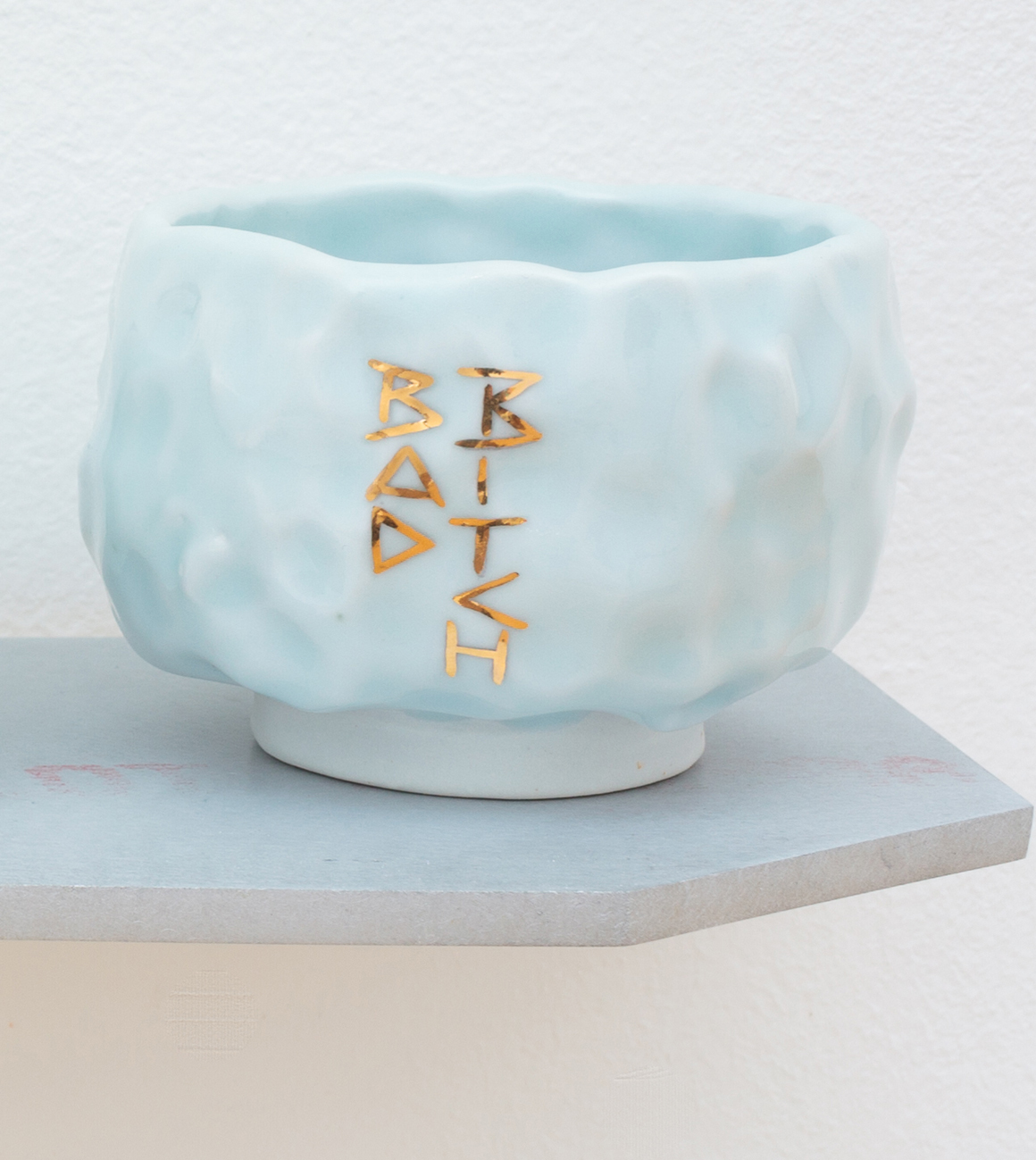 "<p><span class=""name"">Patrice Renee Washington</span><br><em>Bad Bitch Cup (1)</em><span class='media'>Glazed porcelain, gold luster, aluminum, Sculpey clay</span>2.5 x 3 x 3in<br>2016<br><a class='inquire' href='mailto:info@gildargallery.com?subject=Artwork Inquiry PWAS0002&body=I am interested in finding out more about Bad Bitch Cup (1) by Patrice Renee Washington'>Inquire</a></p>"