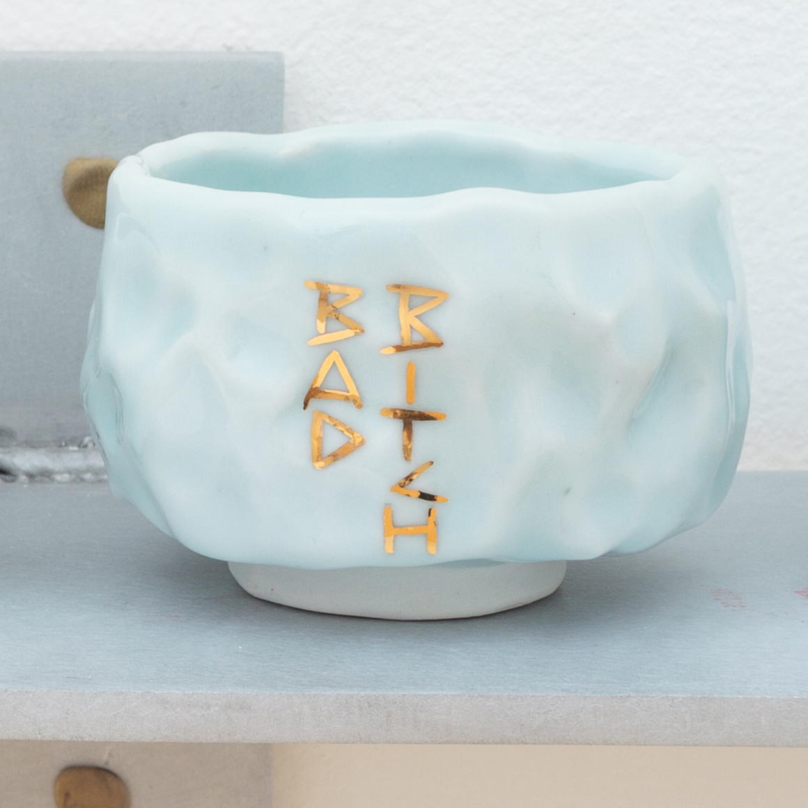 "<p><span class=""name"">Patrice Renee Washington</span><br><em>Bad Bitch Cup (2)</em><span class='media'>Glazed porcelain, gold luster, aluminum, Sculpey clay</span>2 x 2.7625 x 2.7625in<br>2016<br><a class='inquire' href='mailto:info@gildargallery.com?subject=Artwork Inquiry PWAS0003&body=I am interested in finding out more about Bad Bitch Cup (2) by Patrice Renee Washington'>Inquire</a></p>"
