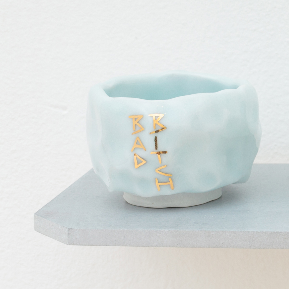 "<p><span class=""name"">Patrice Renee Washington</span><br><em>Bad Bitch Cup (5)</em><span class='media'>Glazed porcelain, gold luster, aluminum, Sculpey clay</span>1.7625 x 2.25 x 2.25in<br>2016<br><a class='inquire' href='mailto:info@gildargallery.com?subject=Artwork Inquiry PWAS0006&body=I am interested in finding out more about Bad Bitch Cup (5) by Patrice Renee Washington'>Inquire</a></p>"