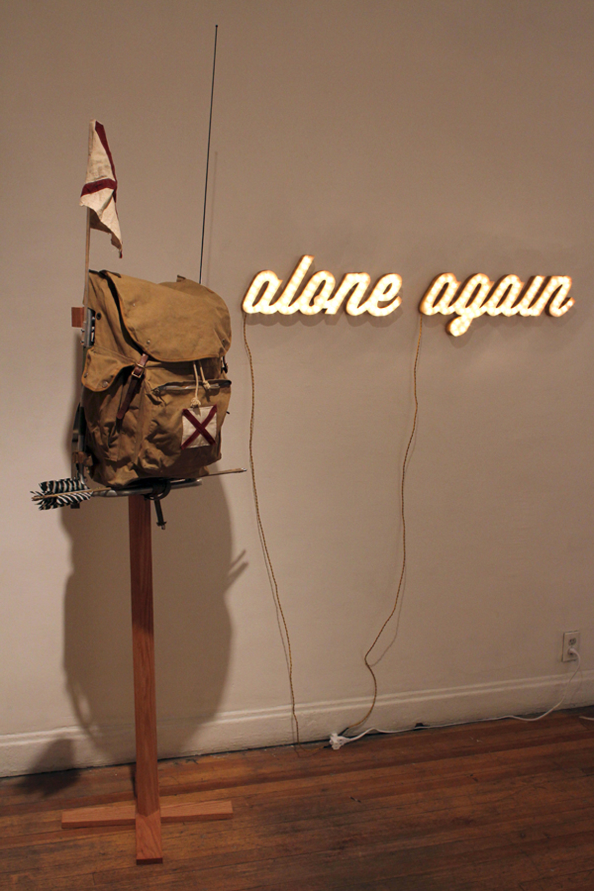 "<p><span class=""name"">Ryan Everson</span><br><em>Alone Again (Pack)</em><span class='media'>vintage scout pack, handmade bamboo arrows, radio, canvas patches and flag, oak stand</span>78 x 31 1/2 x 16in<br>2013<br><a class='inquire' href='mailto:info@gildargallery.com?subject=Artwork Inquiry REVE0006&body=I am interested in finding out more about Alone Again (Pack) by Ryan Everson'>Inquire</a></p>"