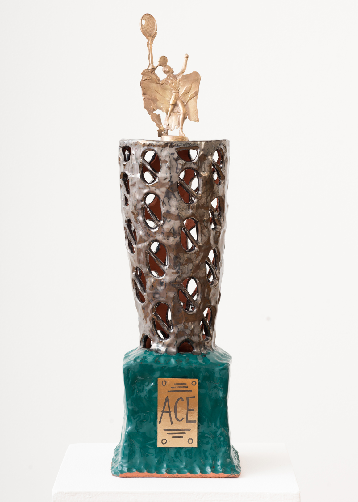 "<p><span class=""name"">Stephanie Kantor</span><br><em>Trophy (Ace)</em><span class='media'>Earthenware, glaze, bronze, brass</span>24 x 6.5 x 6.5 in (61 x 16.5 x 16.5 cm)<br>2018<br><a class='inquire' href='mailto:info@gildargallery.com?subject=Artwork Inquiry SKAN0001&body=I am interested in finding out more about Trophy (Ace) by Stephanie Kantor'>Inquire</a></p>"