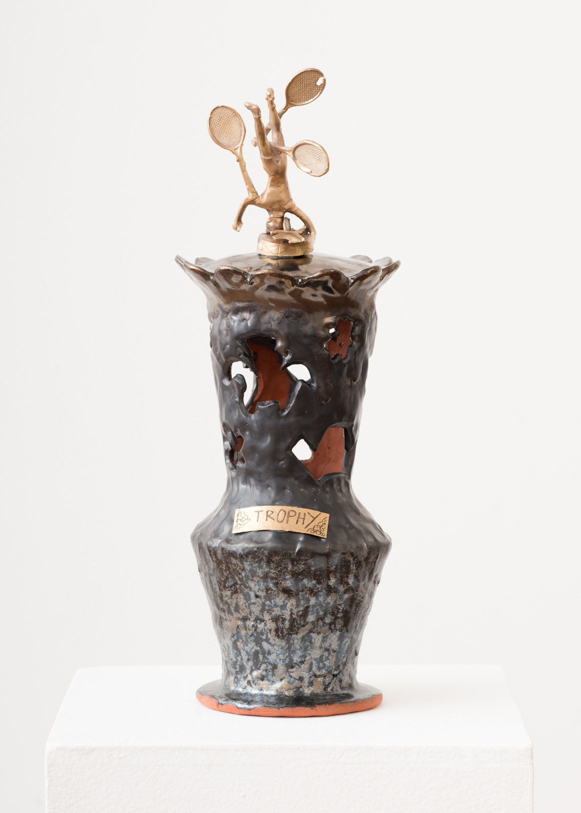 "<p><span class=""name"">Stephanie Kantor</span><br><em>Trophy (trophy)</em><span class='media'>Earthenware, glaze, bronze, brass</span>17 x 6 x 6 in (43.2 x 15.2 x 15.2 cm)<br>2018<br><a class='inquire' href='mailto:info@gildargallery.com?subject=Artwork Inquiry SKAN0003&body=I am interested in finding out more about Trophy (trophy) by Stephanie Kantor'>Inquire</a></p>"