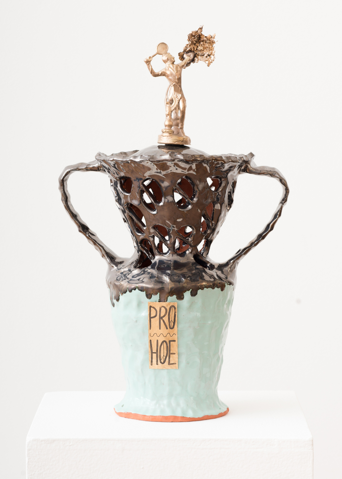 "<p><span class=""name"">Stephanie Kantor</span><br><em>Trophy (Pro Hoe)</em><span class='media'>Earthenware, glaze, bronze, brass</span>18 x 11.5 x 7.5 in (45.7 x 29.2 x 19.1 cm)<br>2018<br><a class='inquire' href='mailto:info@gildargallery.com?subject=Artwork Inquiry SKAN0007&body=I am interested in finding out more about Trophy (Pro Hoe) by Stephanie Kantor'>Inquire</a></p>"