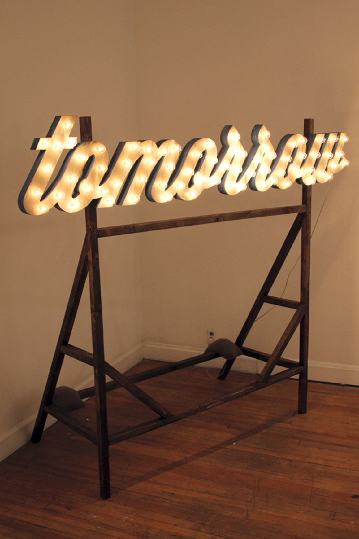 """<p><span class=""""name"""">Ryan Everson</span><br><em>Tomorrow</em><span class='media'>MDF, lights, wood scaffolding</span>18 x 83 x 32 in (45.7 x 210.8 x 81.3 cm) Letters Only<br>2013<br><a class='inquire' href='mailto:info@gildargallery.com?subject=Artwork Inquiry REVE0008&body=I am interested in finding out more about Tomorrow by Ryan Everson'>Inquire</a></p>"""